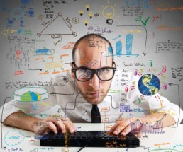 Growth Hacking: Businessman checking statistics and diagrams on pc